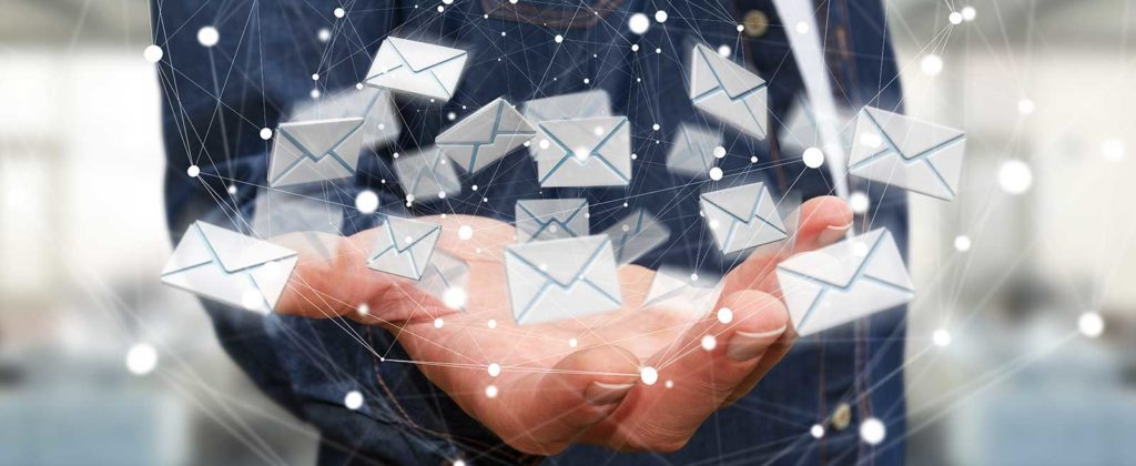 flying email icons in palm of hand
